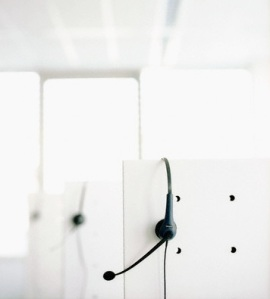 Headphones Hanging Over Cubicle Walls